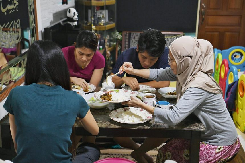 A family having a pre-fasting meal before sunrise on the first day of Ramadan on April 24, 2020.