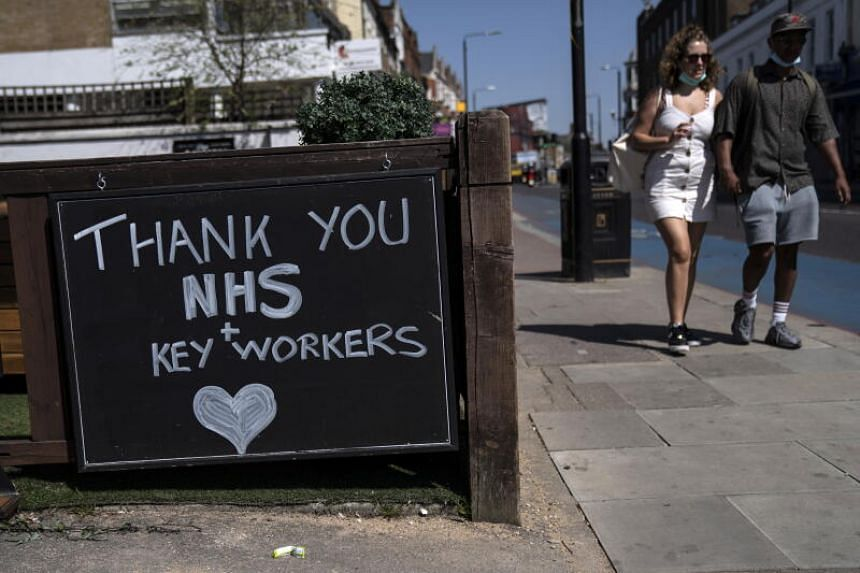A sign thanking the NHS is seen near Tooting Broadway Market in London.