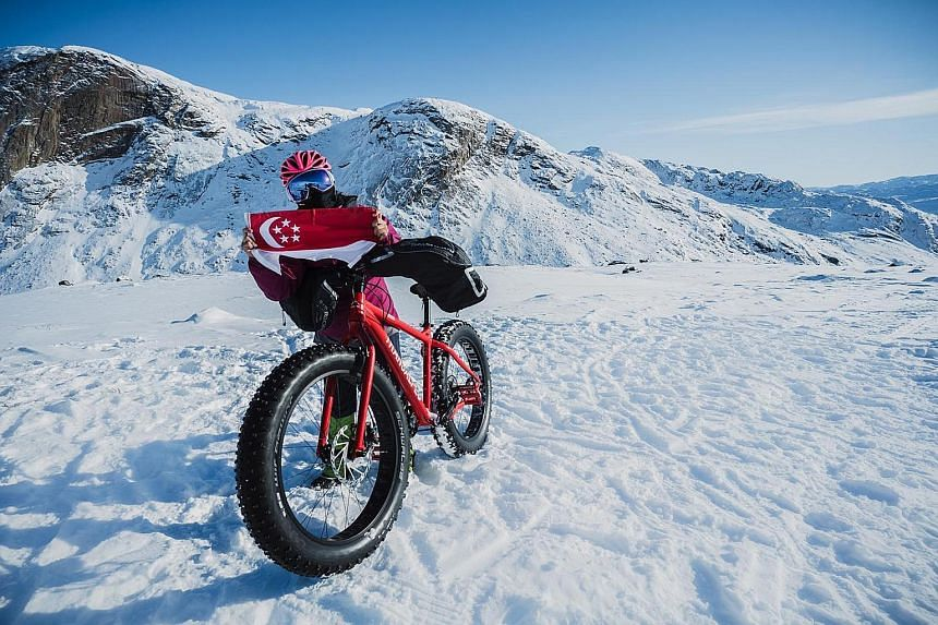 Ms Sandra Lim is the first Singaporean to bike across the Arctic Circle Trail of Greenland in winter.