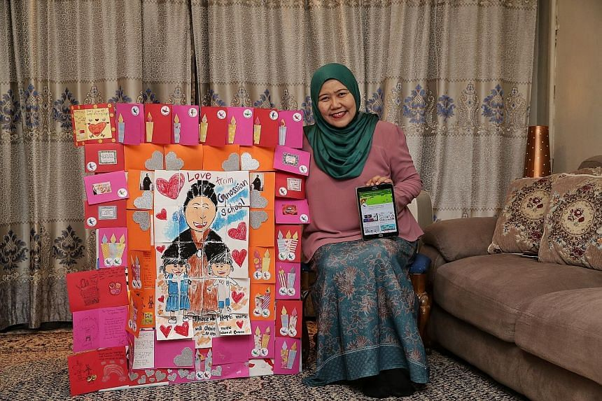 Madam Rahimah A. Rahim with a montage of cards from children and The Get Well Card Project video series on her tablet.