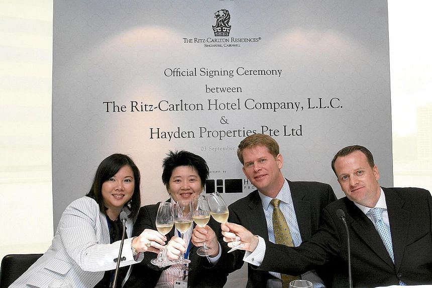 (From left) Ms Suparman with KOP co-founder Ong Chih Ching and Ritz-Carlton executives at the official signing ceremony for The Ritz-Carlton Residences in 2008. KOP group chief executive Leny Suparman recalls how even as a child, she was always inter