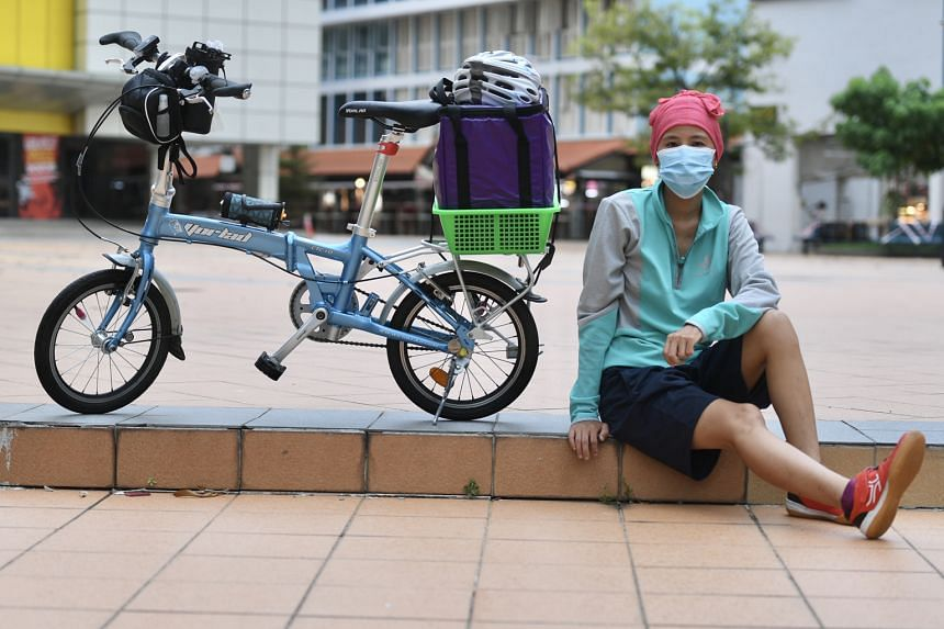 Food delivery rider Clare Tan now sanitises her hands and mobile phone regularly and cycles around with a surgical mask on. She also delivers more orders without seeing the customers, as more people embrace the idea of contactless delivery as a preca