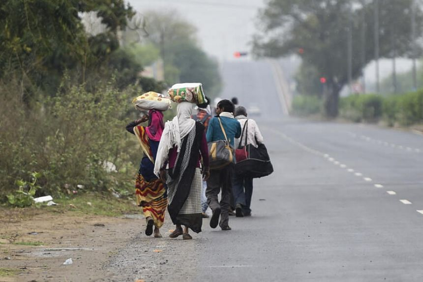 The woman was one of thousands of daily wage workers returning to their home towns by foot during India's lockdown.