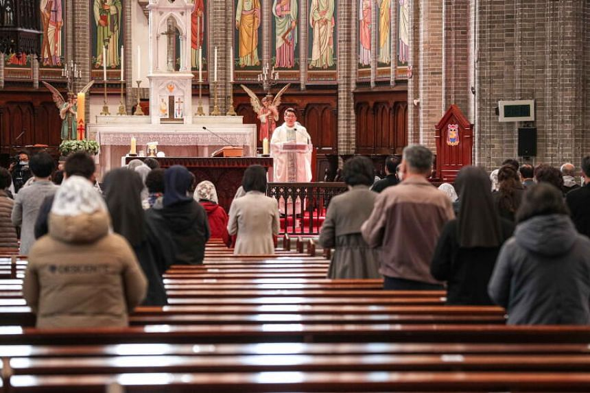 Catholics attending mass while maintaining social distancing at Myeongdong Cathedral in Seoul, South Korea, on April 23, 2020.