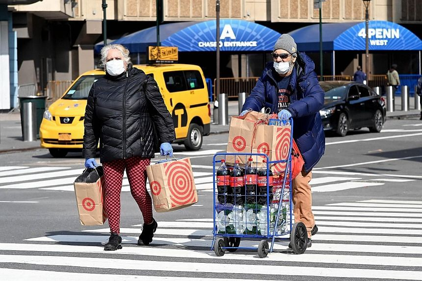 People out shopping in New York last Saturday. The US Centres for Disease Control and Prevention has registered an increase in calls of people exposing themselves to or ingesting cleaners and disinfectants