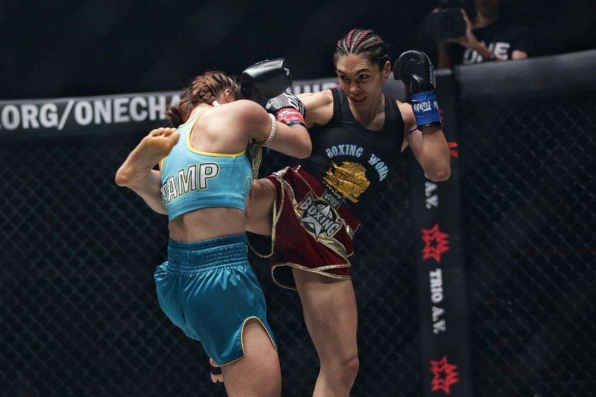 Janet Todd (right) kicks Stamp Fairtex during their Atomweight Kickboxing World Championship bout at the Singapore Indoor Stadium on Feb 28, 2020.