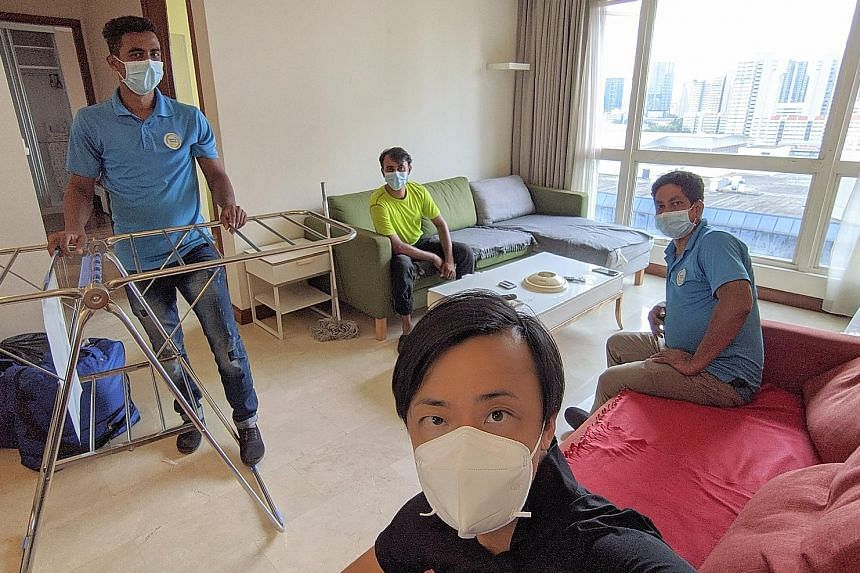 Mr Clarence Chua (foreground) managed to move three of his employees - (from left) Mr Ibrahim Darzi, Mr Md Jowel Rana and Mr Roy Kumar - out of Sungei Tengah Lodge to an apartment in Bugis.