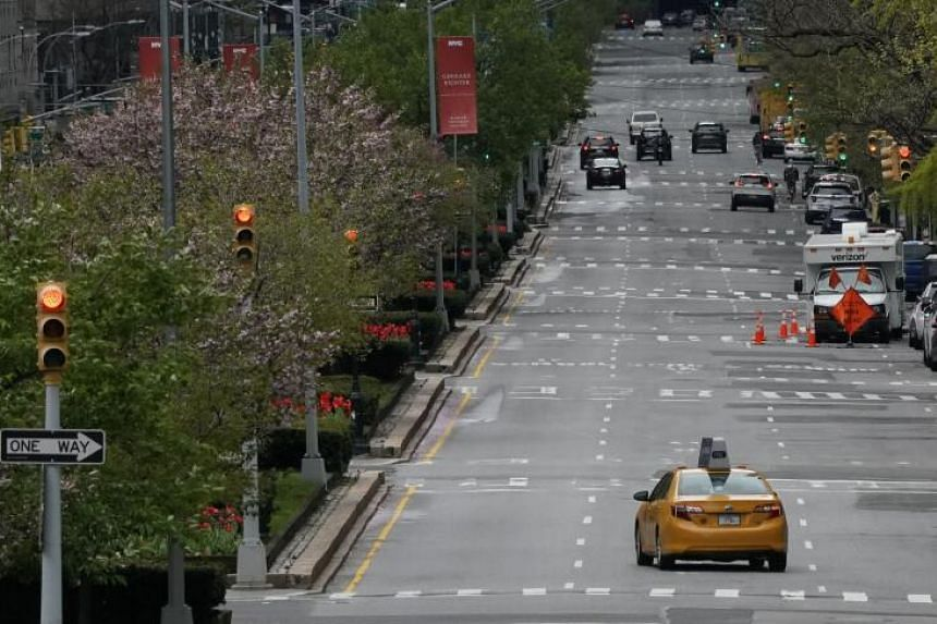 A cab goes down a empty Park Avenue in New York city on April 27, 2020.