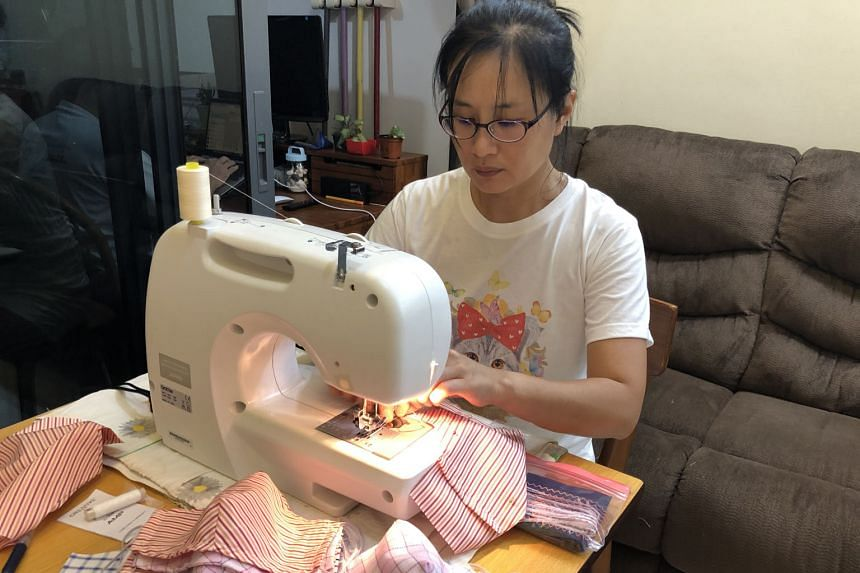 Madam Choong Chui Ping, a volunteer at Buddhist charity Tzu Chi Foundation (Singapore), sews masks from 8pm to 11pm every day. The cloth masks are distributed to those who have trouble getting surgical masks, such as migrant workers, the elderly and