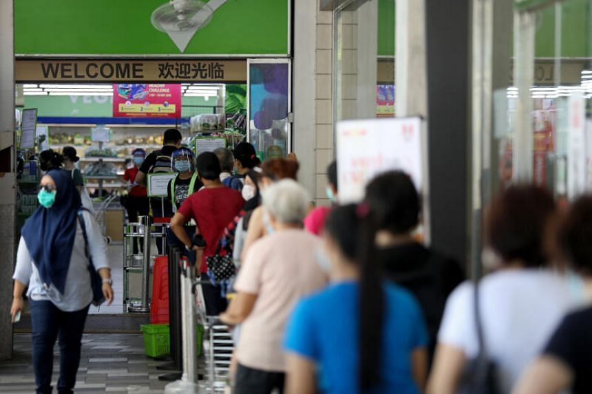 Shoppers queueing to enter a Sheng Siong supermarket in Bedok on April 22, 2020.