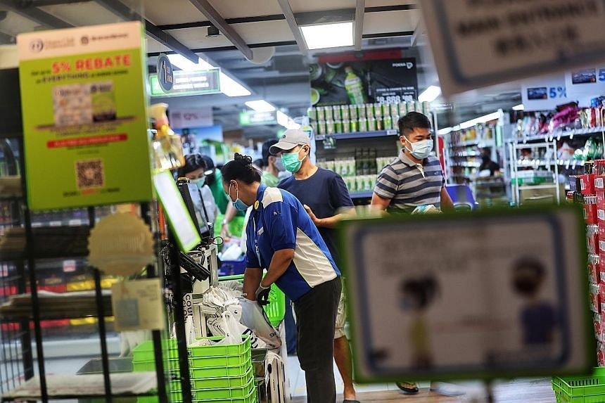 The Sheng Siong supermarket at Junction 10. When the pandemic situation normalises, the group expects revenue to taper off from the current elevated levels as buffer stocks kept by households are consumed.