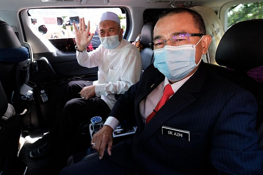 Malaysian Deputy Health Minister Noor Azmi Ghazali (right) and Perak state Cabinet member Razman Zakaria had visited an infected area for social purposes on April 18, an activity banned by the movement control order.