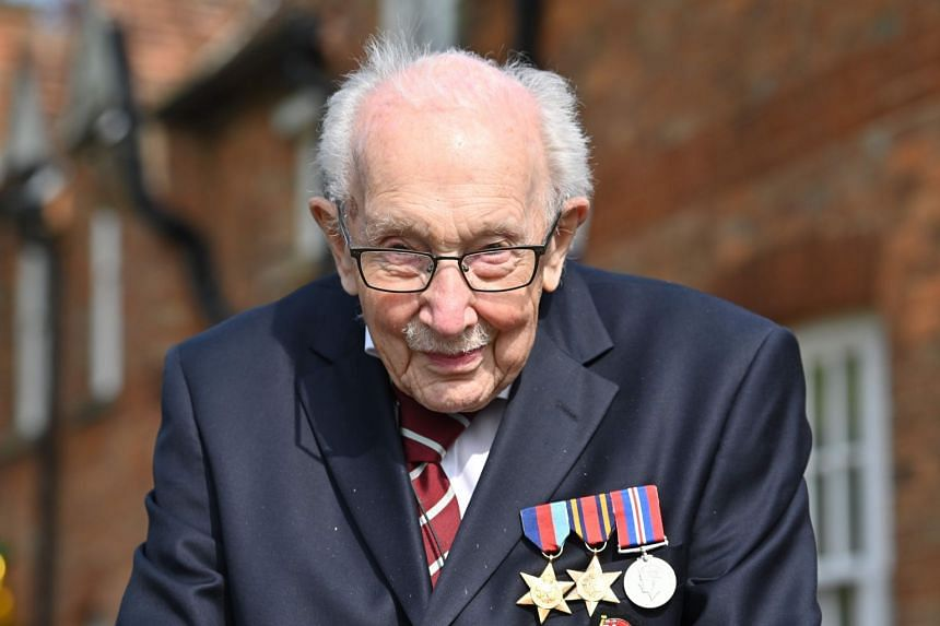 Captain Tom Moore, 99, poses while doing a lap of his garden in the British village of Marston Moretaine.