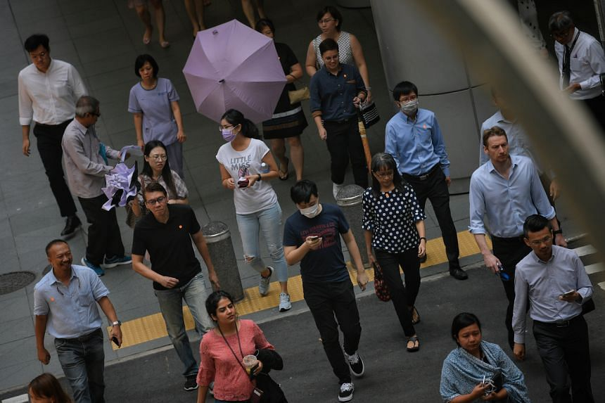 People in the CBD on March 10, 2020. The decline in Q1 is due to a significant reduction in foreign employment.