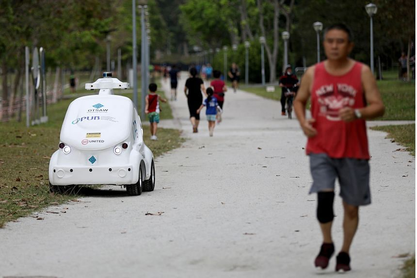 The O-R3 is an autonomous robot used by water agency PUB to broadcast safe-distancing messages at Bedok Reservoir park.