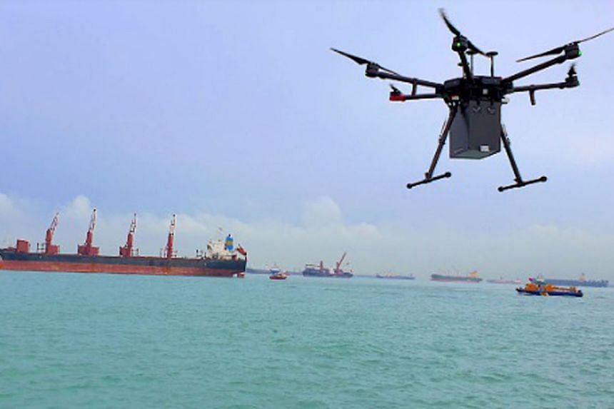 A drone delivery trial flight by local start-up F-drones last December. F-drones is the first company to receive authorisation from the Civil Aviation Authority of Singapore for such deliveries. The service's first delivery here, of a parcel containi