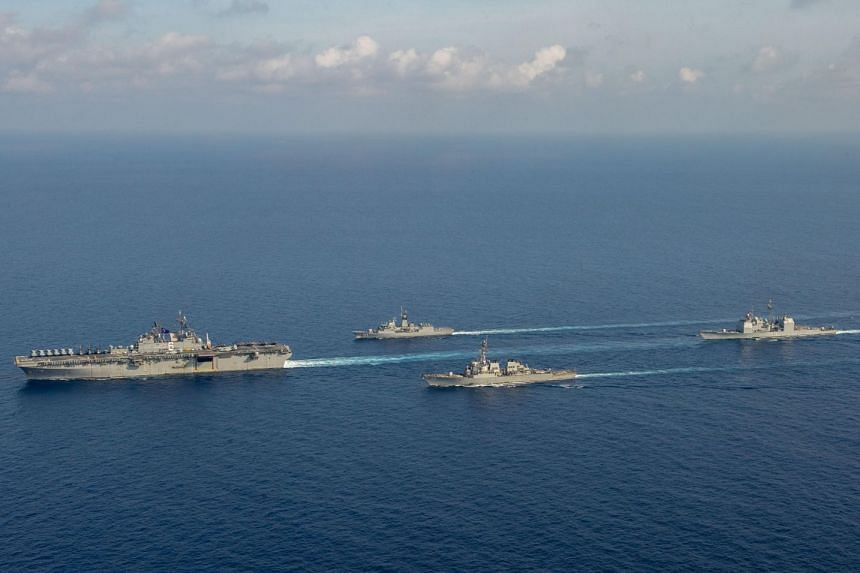 The USS Barry (third from left) joins other ships in officer of the watch manoeuvres in the South China Sea, on April 18, 2020.