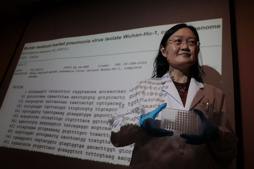Cell biologist Ong Siew Hwa, director and chief scientist at Acumen Research Laboratories with a diagnostic kit that her company has developed for the coronavirus.