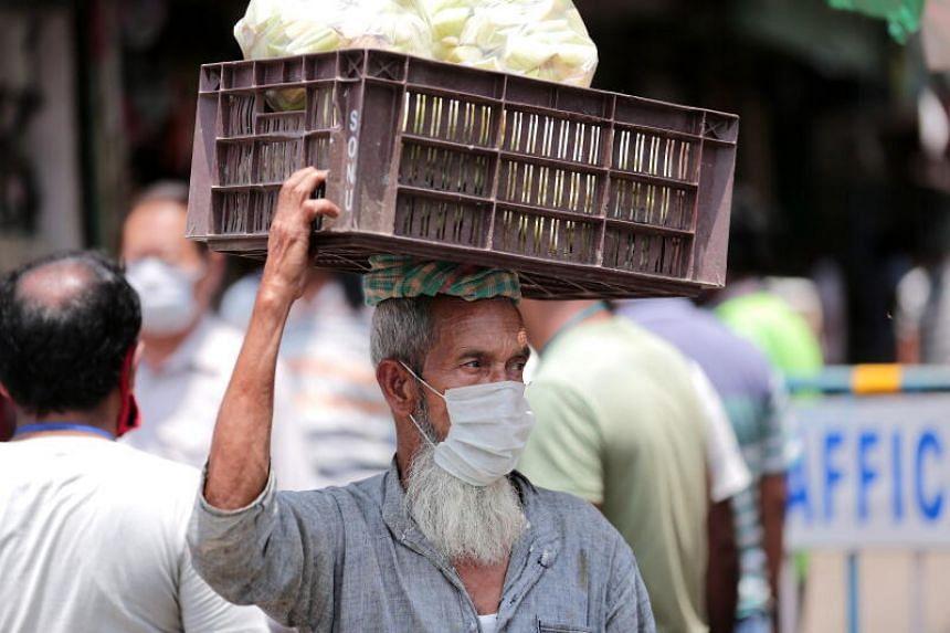 An Indian vendor leaves a market during lockdown in Kolkata, on April 29, 2020.