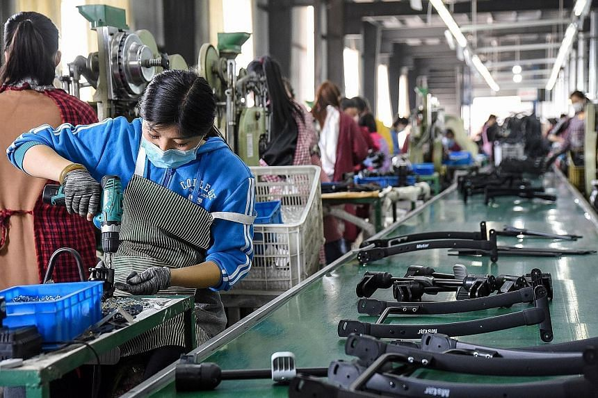Workers at a baby carriage factory in Handan, China's Hebei province, this week. The Chinese economy took a heavy blow in the first quarter, shrinking an annual 6.8 per cent, the first contraction since current quarterly records began almost 30 years