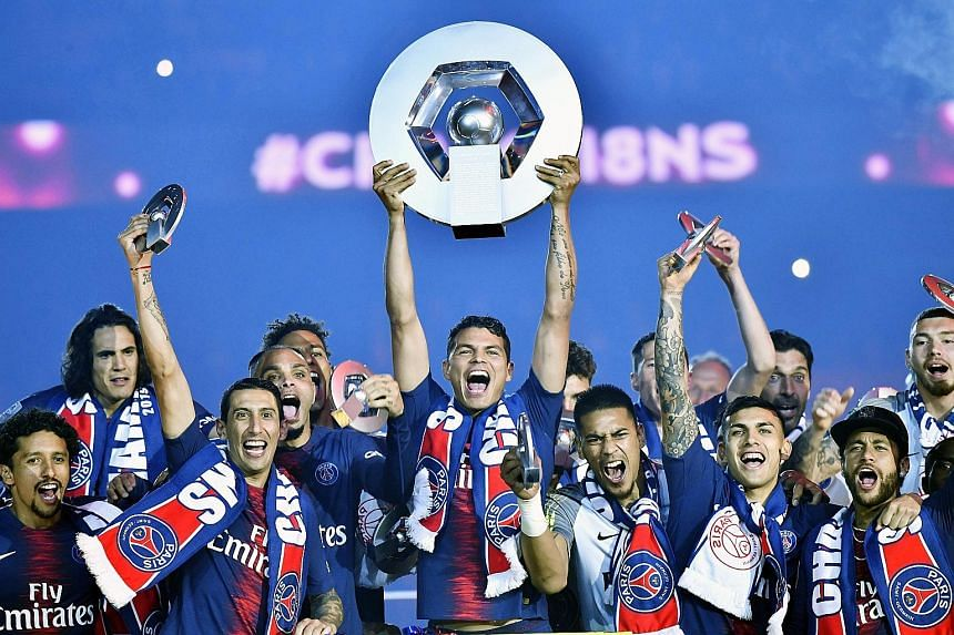 Paris Saint-Germain players celebrating with the Ligue 1 trophy last year. They have been crowned champions for the third year running, after the French League decided to end the season prematurely.