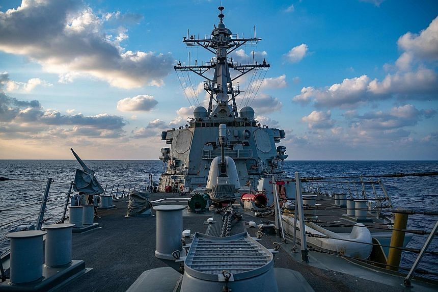 U.S. destroyer sails through South China Sea waters China claims