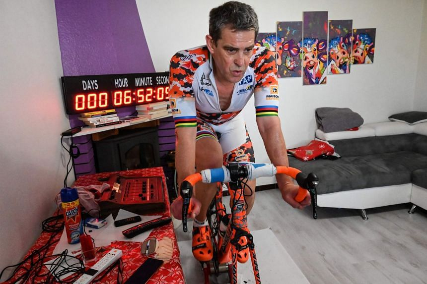 Triathlete Pascal Pich pedalling furiously in his living room in Savignargues, near Nimes in southern France. He has covered nearly 8,000km on the clock to raise funds to buy equipment for the healthcare staff mobilised against the coronavirus.