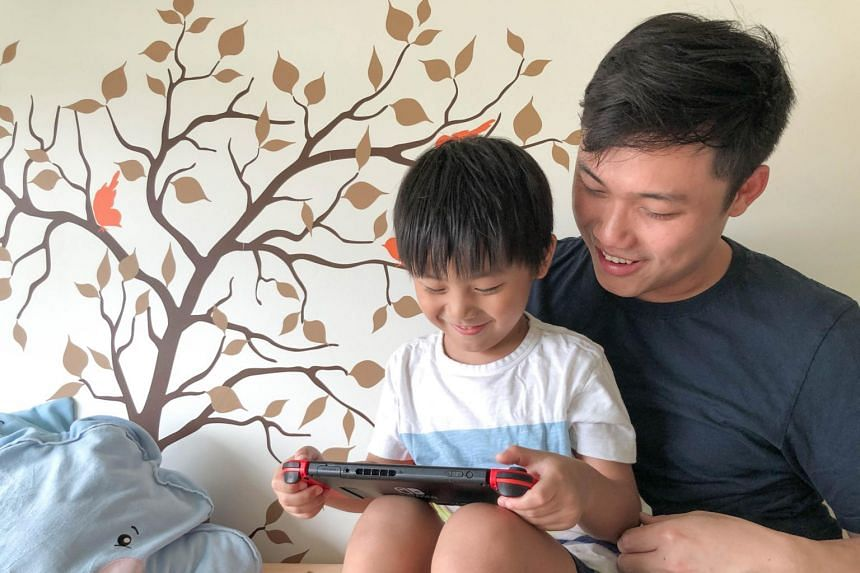 Faculty Early Career Award Fellow at the Singapore University of Technology and Design Andrew Yee (right) with his son, Noah.