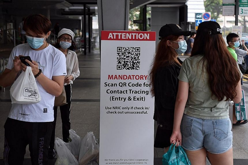 A QR code scanning station outside Nex mall in Serangoon Central. QR codes will be used at places with transient populations who are on the move. ST PHOTO: KUA CHEE SIONG