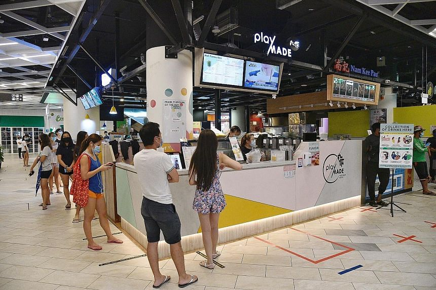 Bubble tea outlets such as Playmade at PLQ Mall (above) and iTea at Tampines Street 81 on April 21 were overwhelmed after more businesses were told to temporarily close at 11.59pm the same day. Koi teamed up with online restaurant Grain to offer bubble te