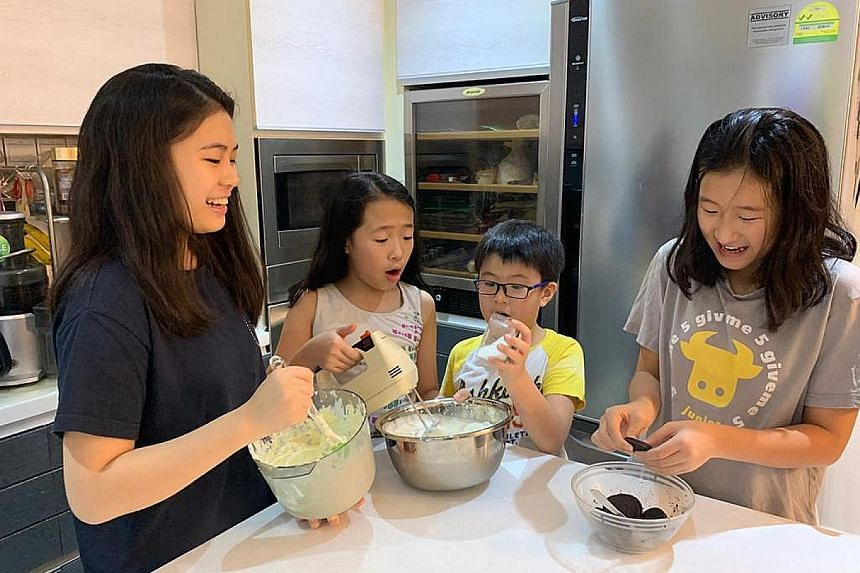 Assistant Professor Jiow Hee Jhee bakes with his children (above) almost daily. He believes in finding creative alternatives to screen time during the circuit breaker period.