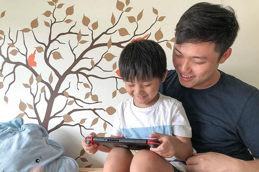 """Dr Andrew Yee with his son, Noah. Dr Yee believes that parents should not see devices as the """"enemy"""" but as useful tools for education."""