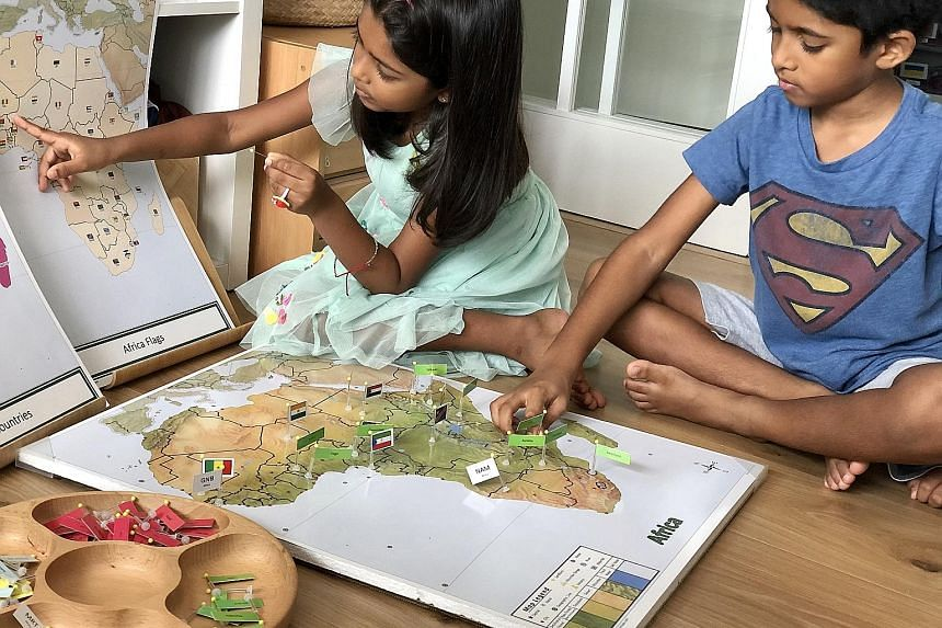 Six-year-old Alisha Sundar and her brother Aryan, eight, exploring different countries during their playtime at home. Recreation for them involves open-ended toys such as wooden blocks and art materials, as well as audio stories for children.