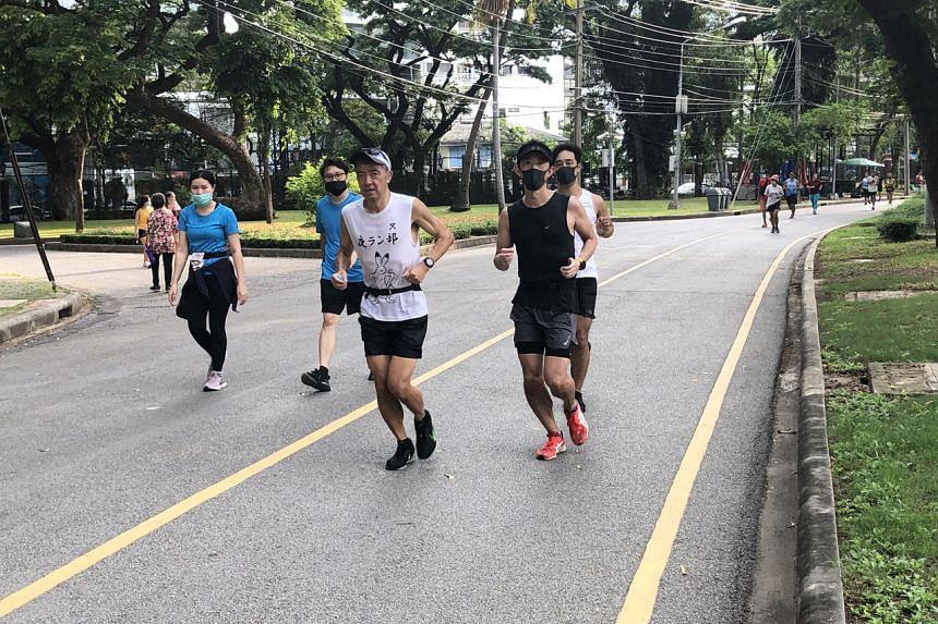 Joggers at Lumphini Park in Bangkok on May 3, 2020.