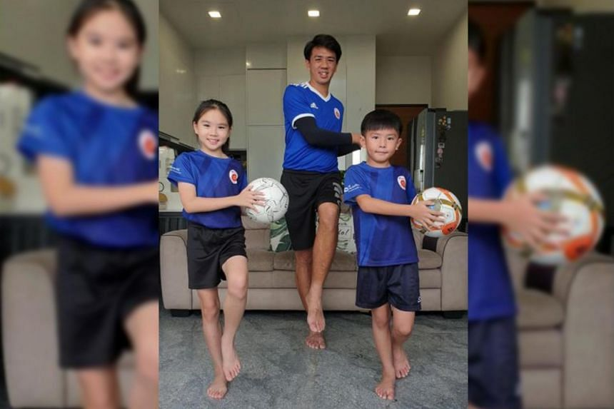 ActiveSG Football Academy coach Jeremy Chiang doing home-based football training with his children, Sasha, 10, and Jaevis, eight. ActiveSG offers many family workouts during the school holidays this month.