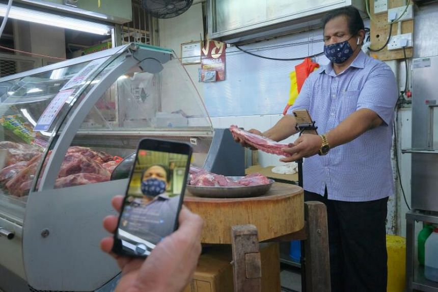 Mr Mohamed Mustafa Shahul Hamid selling meat on Facebook Live in Tekka Market on May 3, 2020.