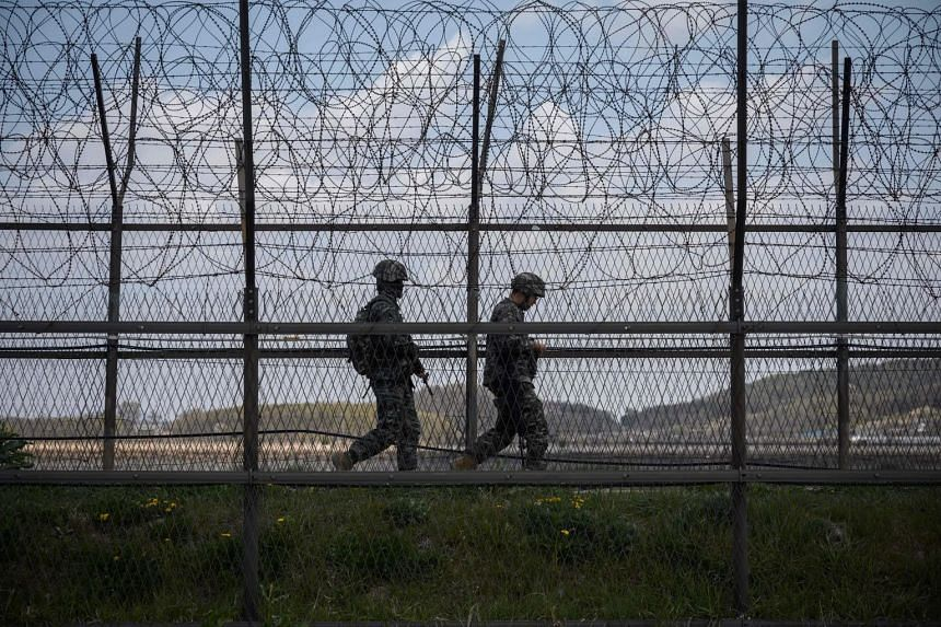 South Korean soldiers patrolling the DMZ separating the two Koreas. Yesterday, troops from the North fired at their counterparts in the South. Seoul says Pyongyang's action was in violation of a 2018 military pact to suspend hostile actions that coul