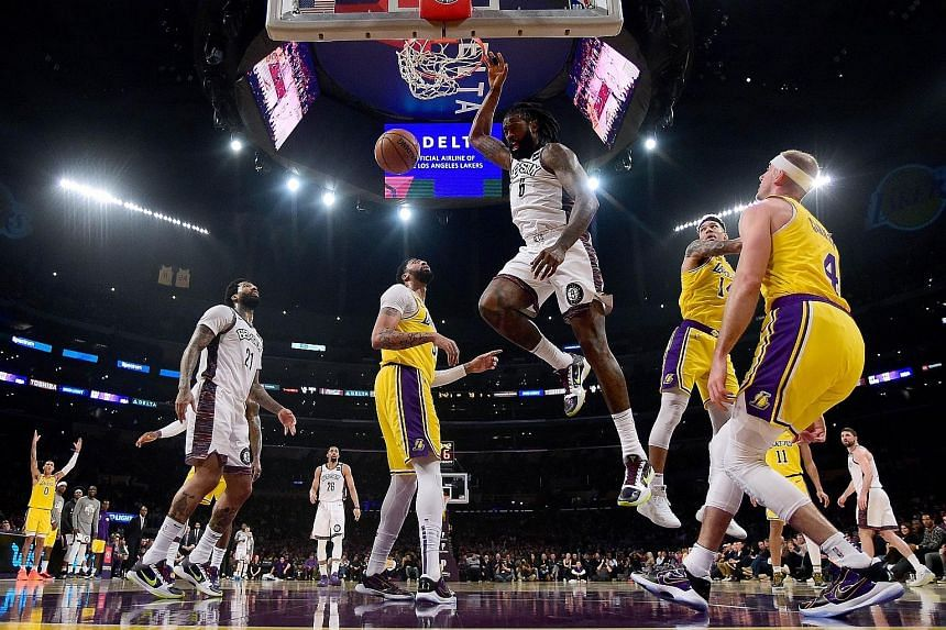 DeAndre Jordan of the Brooklyn Nets dunking during his team's 104-102 win over the Los Angeles Lakers at Staples Centre on March 10, the day before the NBA season was suspended because of the coronavirus crisis.