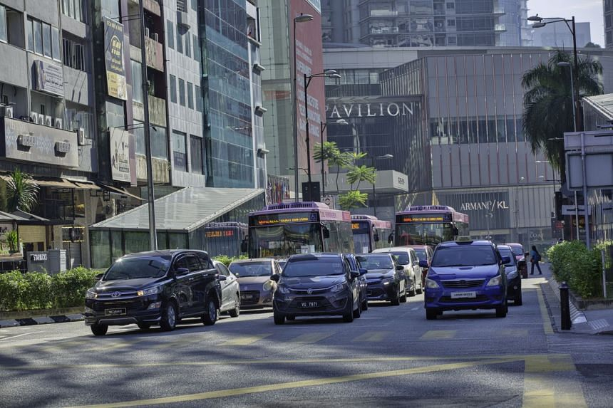 Heavy traffic filled thoroughfares into Kuala Lumpur.