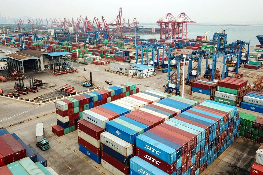 A photo taken on April 14, 2020, shows containers stacked at a port in Lianyungang, China.
