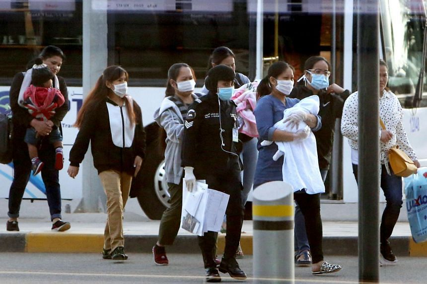 Filipinos who availed general amnesty granted by the Kuwaiti government arrive at the Kuwait International Airport on April 3, 2020.