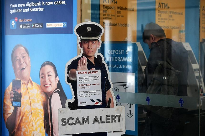 A scam alert notice put up near ATMs at Woodlands MRT station. The police also warned of a rise in bank phishing scams and Internet love scams.