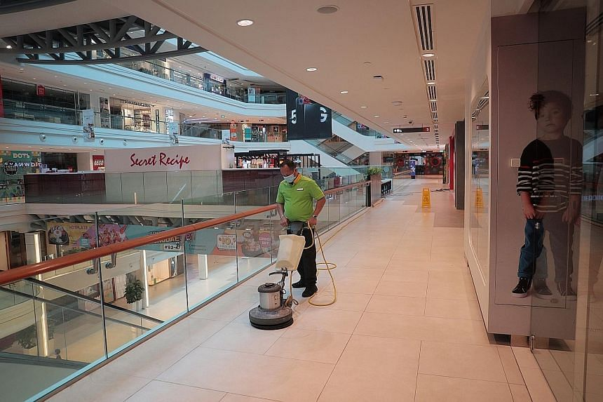 A cleaner at work in Plaza Singapura mall yesterday as shops and businesses remain shuttered for the extended circuit breaker period that ends on June 1. While it was a difficult decision to implement and extend the circuit breaker as businesses and