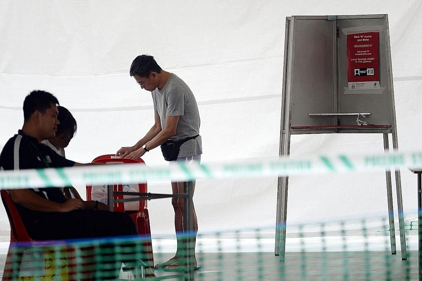 The Parliamentary Elections (Covid-19 Special Arrangements) Act is to ensure the safety of voters, candidates and election officials should Singaporeans have to go to the polls before the pandemic ends. ST PHOTO: JOYCE FANG
