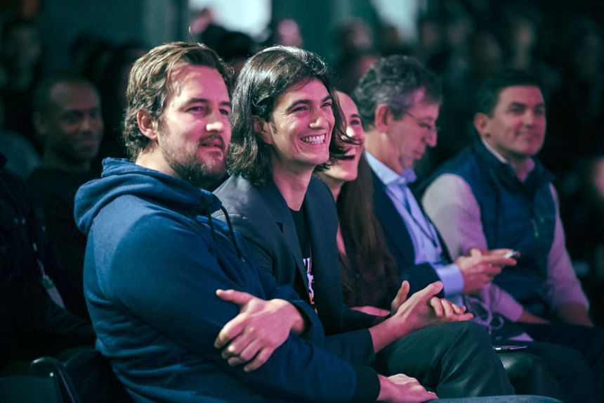 WeWork co-founder Adam Neumann (second from left) said he stepped down as CEO in exchange for the stock buy and promised financing.