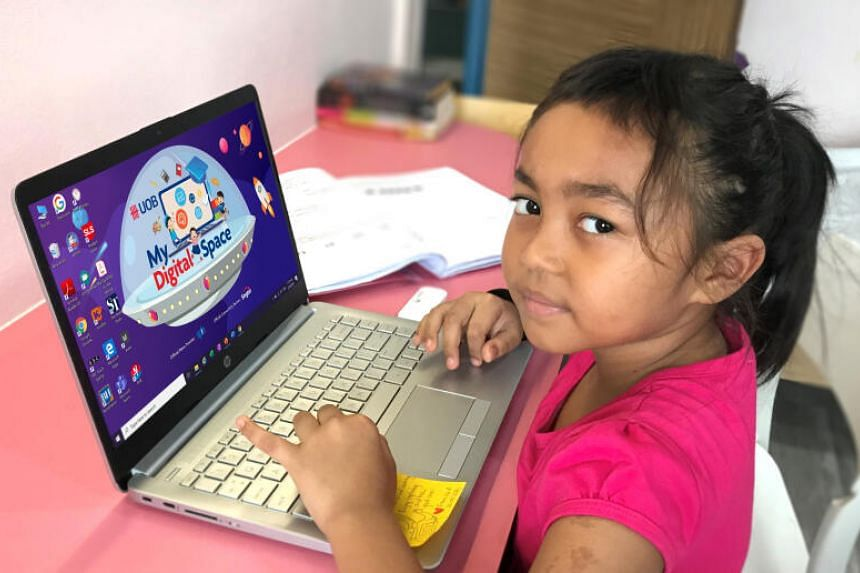 Nur Muliana Mamat from Fuhua Primary School has received a UOB digital learning kit to aid her in her home-based learning.