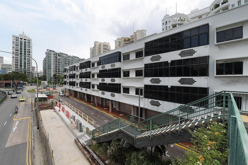 All four sisters inherited shares in four companies set up by their father. Three of the companies held properties, including 56 units in a mixed commercial and residential development in River Valley Road (above).