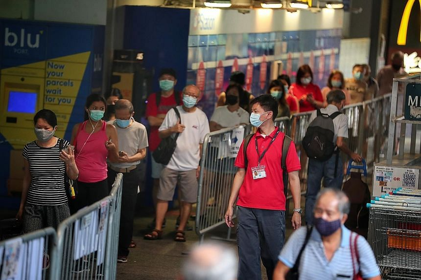 A safe distancing ambassador at work at Clementi Mall on Monday. The attack on Monday has raised concerns among these ambassadors, who ensure safe distancing at parks, malls and other public areas daily. ST PHOTO: KELVIN CHNG
