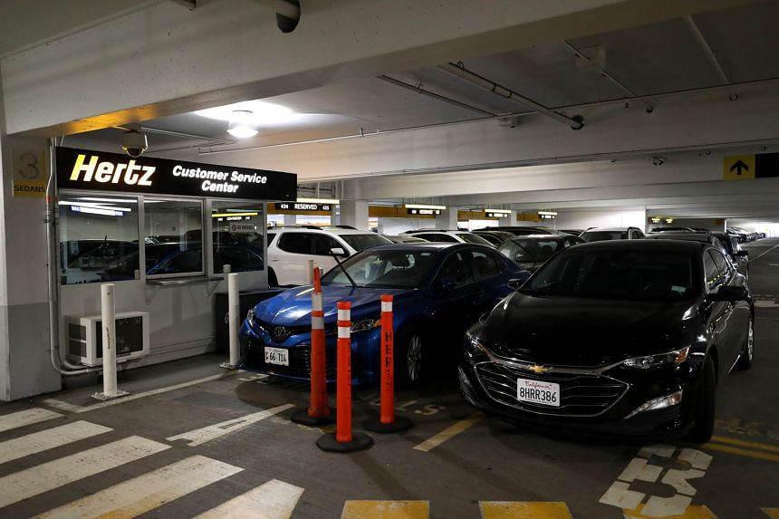 Hertz cars at San Francisco International Airport last week. The rental-car company recently disclosed that it had missed substantial lease payments related to its rental cars.