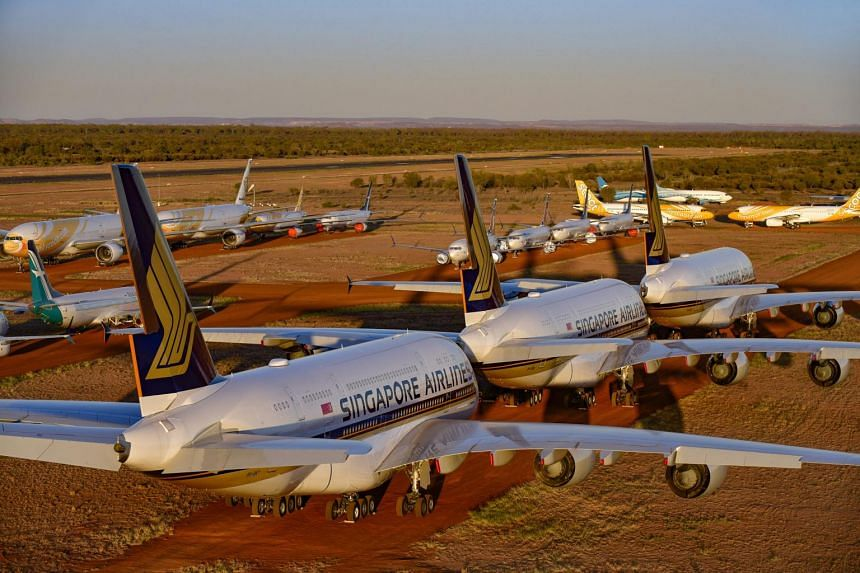17 planes from the Singapore Airlines Group are parked at a facility in Australia's Alice Springs.